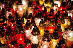 Burning candles at a cemetery during All Saints Day Royalty Free Stock Photography