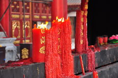 Burning candles. Chinese buddhist temple Royalty Free Stock Photography