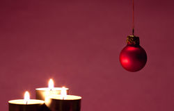Burning candles with Christmas ball Royalty Free Stock Image
