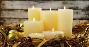 Burning candles with christmas decoration on wooden plank stock footage