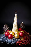 Burning candles and Christmas decorations Stock Images