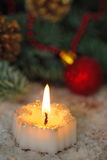 Burning candles with christmas decorations Royalty Free Stock Images