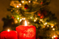 Burning Candles with Christmas Decorations in background Stock Photography