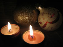 Burning Candles on Christmas Eve. Close up of a burning candle on Christmas Eve royalty free stock images