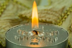 Burning candles with Christmas motifs Royalty Free Stock Photography