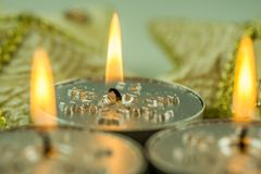Burning candles with Christmas motifs Royalty Free Stock Photos