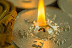 Burning candles with Christmas motifs Stock Photography