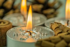Burning candles with Christmas motifs Royalty Free Stock Photo