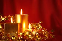 Burning candles in a Christmas setting royalty free stock image