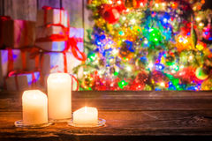 Burning candles and Christmas tree with presents Royalty Free Stock Photos