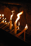 Burning candles in a church. Candles in a church burning during a religious ceremony Royalty Free Stock Photo