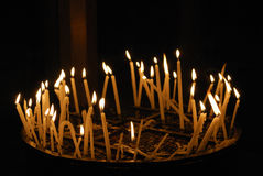 Burning candles in a church. Candles burning in a Church during a religious ceremony Stock Photos