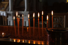 Burning candles in church Stock Photo