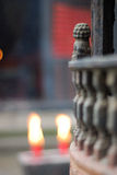 Burning candles in church. Two candle burning outside Asian style church Royalty Free Stock Image