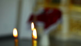 Burning candles in church stock footage