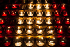 Burning candles in a church Royalty Free Stock Image