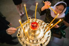 Burning candles in church Royalty Free Stock Photography