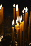 Burning candles in a church Royalty Free Stock Images