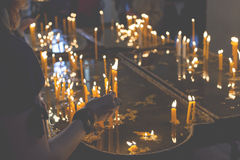 Burning candles in a church on a dark background Royalty Free Stock Photography