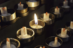 Burning candles in a church Stock Images