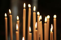 Burning candles at Church. Lots of Burning candles at Church Royalty Free Stock Photos