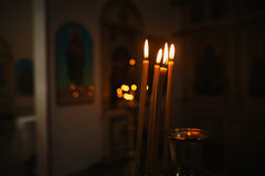 Burning candles in church Royalty Free Stock Images