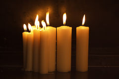 Burning candles in dark Royalty Free Stock Image