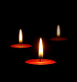 Burning candles in the dark Royalty Free Stock Images