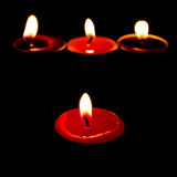 Burning candles on a dark background with warm light Royalty Free Stock Photo