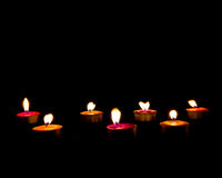 Burning candles on a dark background with warm light ,copyspace Stock Photography