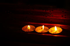 Burning candles on dark background with warm light Royalty Free Stock Images