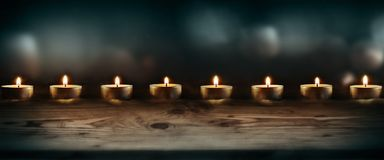 Burning candles with dark blue background Stock Images
