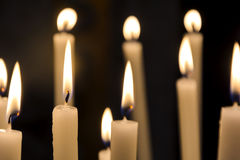 A group of burning candles in a church Royalty Free Stock Photography