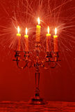 Burning candles emitting rays Royalty Free Stock Photo