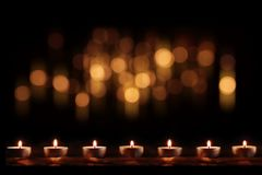 Burning candles with festive golden bokeh Royalty Free Stock Photo