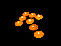 Burning candles in the form of arrows. Royalty Free Stock Photography