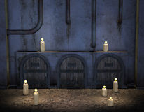 Burning candles in front of an old wall Stock Image