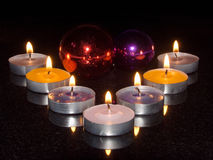 Burning candles and fur-tree toys Royalty Free Stock Images