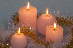 Burning candles. A Garland ensnares burning candles Stock Images