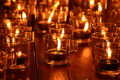 Burning candles in glass Stock Photos