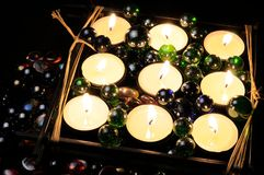 Burning Candles with Glass Stones in the Dark Royalty Free Stock Photo