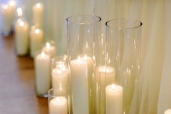 Burning candles in glass vases, blur background, selective focus Royalty Free Stock Photos