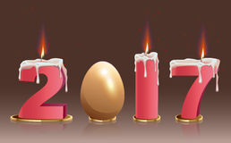 2017 burning candles and golden egg. Illustration in vector format Stock Photography