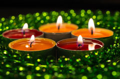 Burning candles and green decor Royalty Free Stock Photography