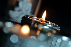 Burning candles green and red Stock Photography