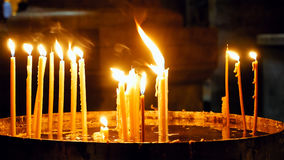 Burning candles in Holy Sepulcher Church Royalty Free Stock Photo