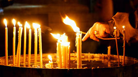 Burning candles in Holy Sepulcher Church Royalty Free Stock Photos