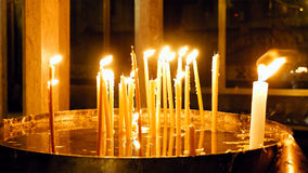 Burning candles in Holy Sepulcher Church Stock Image