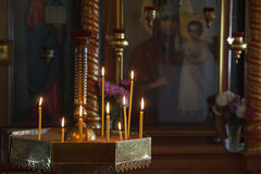 Burning candles at the icon of the mother of God Royalty Free Stock Photos