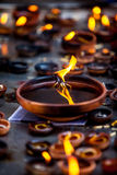 Burning candles in the Indian temple. Stock Photos